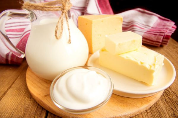 40089889 - dairy products - milk, cheese, butter, sour cream over wooden table